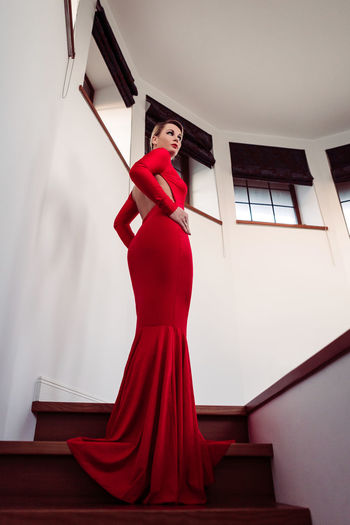 Beautiful woman with red dress standing on stairs. ContactLenses EyeEm Portraits EyeEmNewHere Portrait Of A Woman Red Dress ZombieContacts Beautiful People Beautiful Woman Bottom Dark Beauty Darkart Dress Elégance Fashion Fashion Model Glamour Indoors  Low Angle View One Person People Red Standing Womansbody Young Women Zombiegirl  The Fashion Photographer - 2018 EyeEm Awards