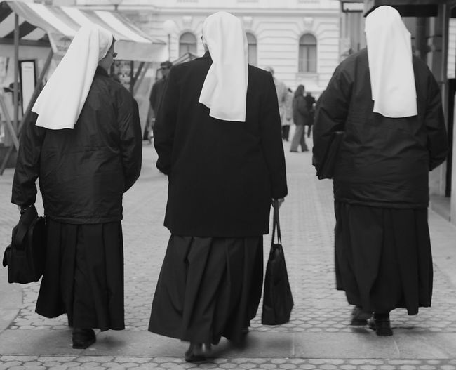 Adult Black And White Dress Day Nun Cap Nuns Outdoors People Sisters Three Nuns Three Sisters Togetherness Walking Nuns Walking Sisters White Nun Cap Women