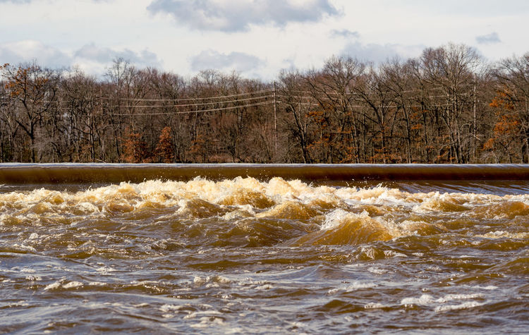 The South River at Duhernal Dam in Old Bridge, New Jersey after a Noreaster Flooding River New Jersey Beauty In Nature Cloud - Sky Day Duhernal Flooding Motion Nature No People Noreaster Outdoors River Scenics Sky South River The South River Tranquil Scene Tranquility Tree Water Waterfront Wave