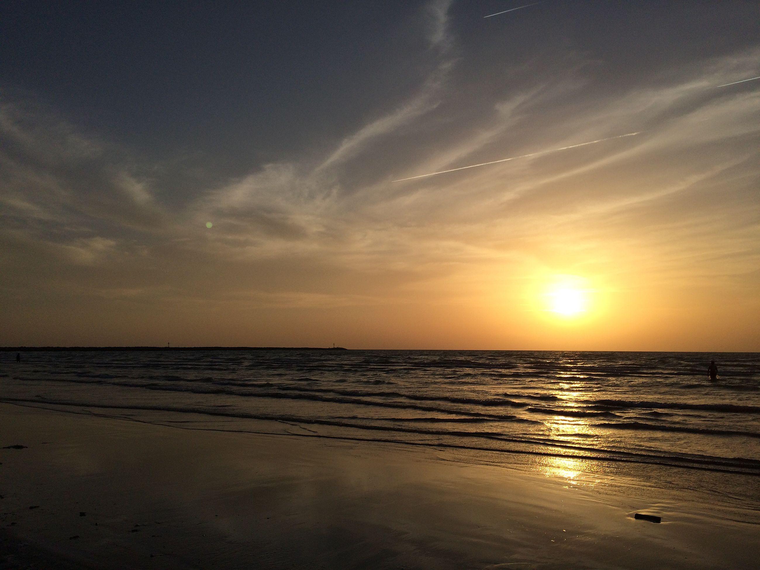 sea, horizon over water, beach, water, sunset, tranquil scene, scenics, tranquility, beauty in nature, shore, sky, reflection, sun, sand, idyllic, nature, orange color, coastline, sunlight, wave