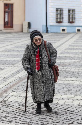 Portrait of man standing on street