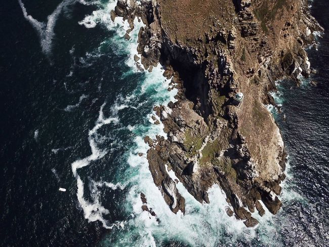 Cape of Good Hope Beauty In Nature Cave Close-up Day High Angle View Natural Arch Nature No People Outdoors Physical Geography Rock - Object Rock Formation Scenics Sea Textured  Tranquility Water