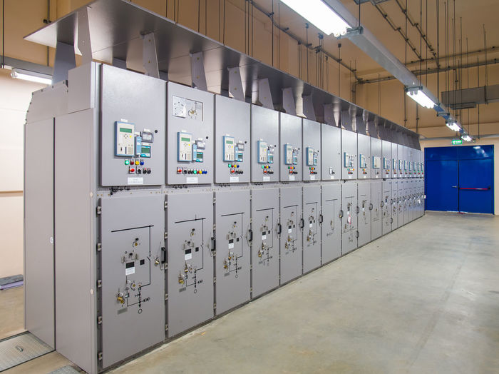 Indoors  In A Row Illuminated Technology Control Security No People Safety Industry Electricity  Protection Locker Fuel And Power Generation Lighting Equipment Communication Architecture Metal Machinery Side By Side Repetition Meter - Instrument Of Measurement Ceiling Power Supply Switchgear