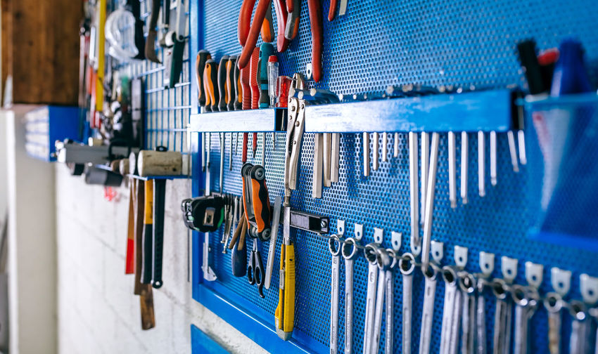Close-up of work tools hanging at workshop