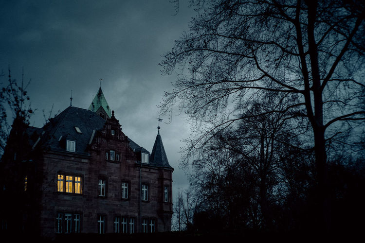 Building Exterior Tree Architecture Built Structure Building Dusk Nature Low Angle View Cloud - Sky No People Bare Tree The Past History Silhouette Outdoors Dark Spire  Gothic Style Eerie Atmosphere Creepy Haunted House Hidden Places Cinematic darkness and light