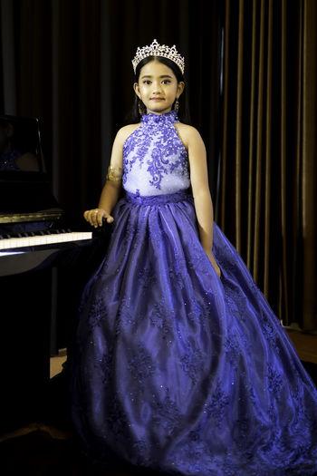 Portrait of girl wearing gown