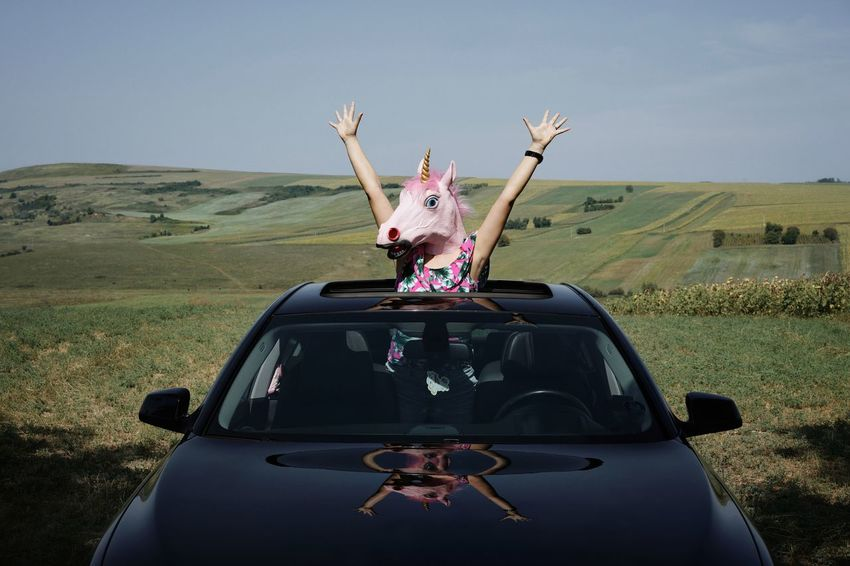 Landscape Nature Unicorn Unicorn Head One Woman Only One Person Sunroof Car Sunroof People Young Women Desert Adventure Escape Car Road Trip Surreal Arms Raised Sky Waving Be Brave A New Beginning