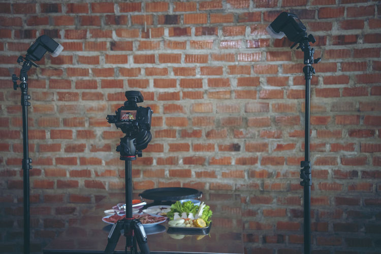View of electric lamp on brick wall