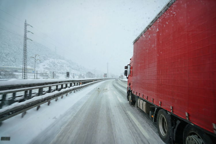 Vehicle trailer on snow covered road
