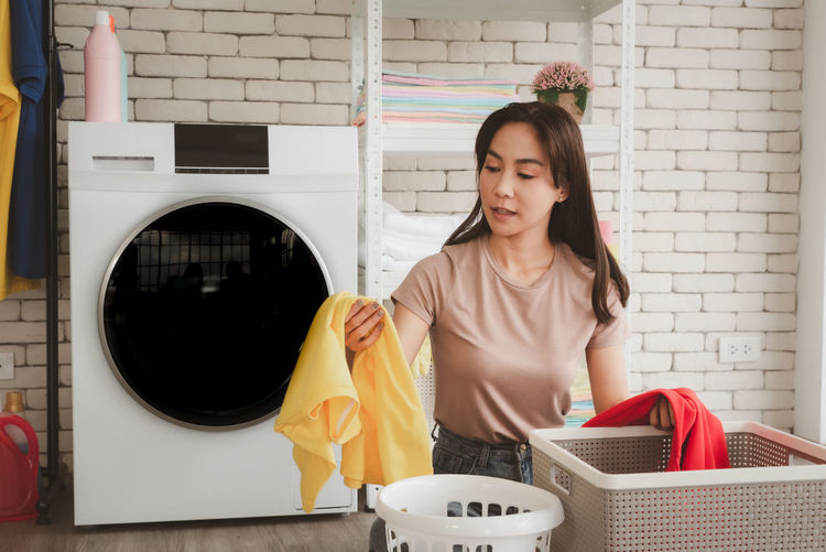 Woman cleaning clothes at laundry
