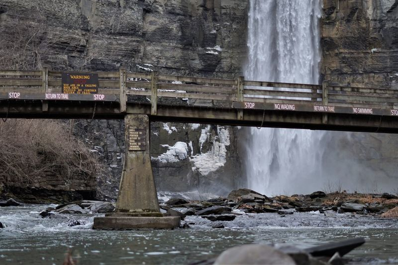 Scenic view of river flowing through bridge