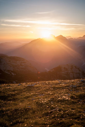 Watching the sun go down in the mountains Sky Sun Scenics - Nature Mountain Environment Sunlight Beauty In Nature Landscape Nature Sunset Tranquility Cloud - Sky Mountain Range No People Tranquil Scene Lens Flare Sunbeam Outdoors Idyllic Land Bright