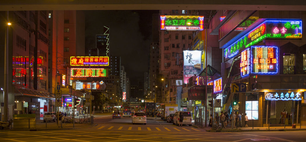Hong Kong HongKong Architecture Building Exterior Built Structure Car City City Life City Street Communication Illuminated Incidental People Mode Of Transportation Motion Motor Vehicle Neon Night Nightlife Outdoors Road Sign Street Text Transportation