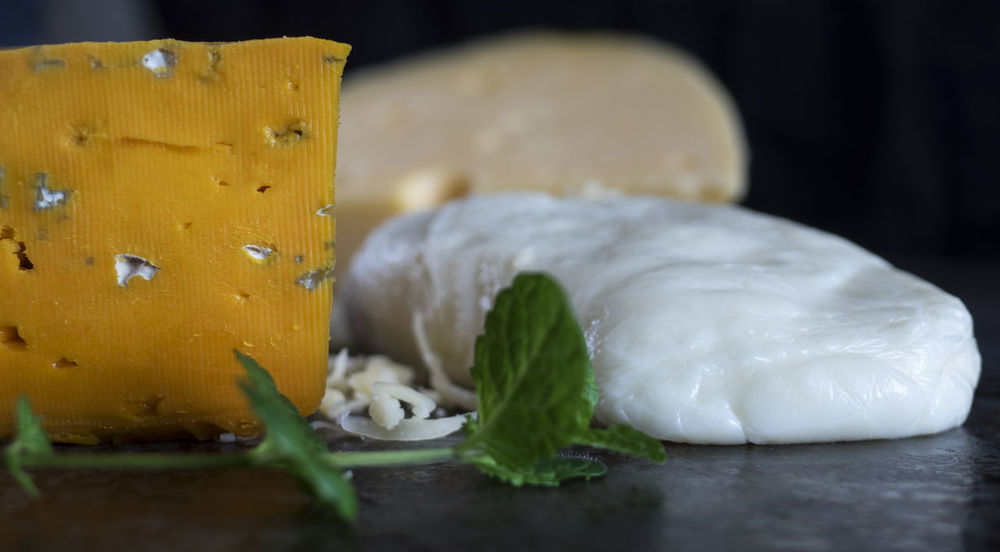 Fresh pieces of cheese (Mozzarella, roquefort, Maasdam) on the stone table Background Black Cheese Close-up Day Food France Fresh Freshness Healthy Eating Indoors  Italy Maasdam Mint Mozzarella Netherlands No People Pieces Roquefort Slate Switzerland Table