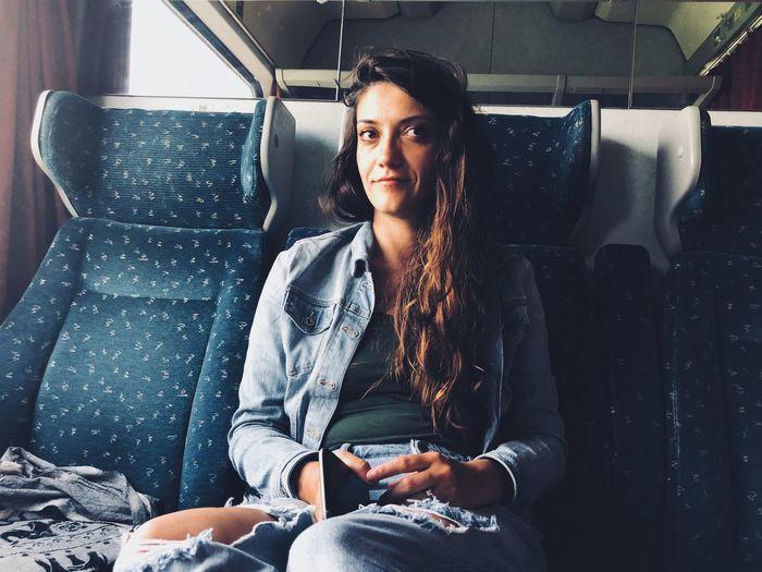 Portrait of woman sitting in train
