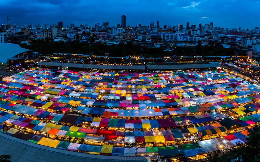 night market in bangkok thailand Night Market Twilight City Cityscape Urban Skyline Business Finance And Industry Multi Colored Skyscraper Sky Architecture Farmer Market Market Stall Market For Sale Street Market