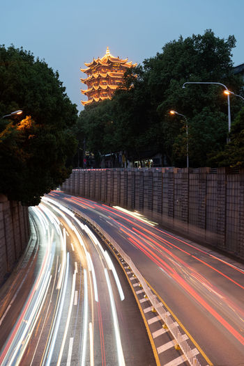 Architecture Blurred Motion Building Exterior Built Structure City Illuminated Light Trail Long Exposure Mode Of Transportation Motion Nature No People Outdoors Plant Road Sky Speed Street Street Light Transportation Tree