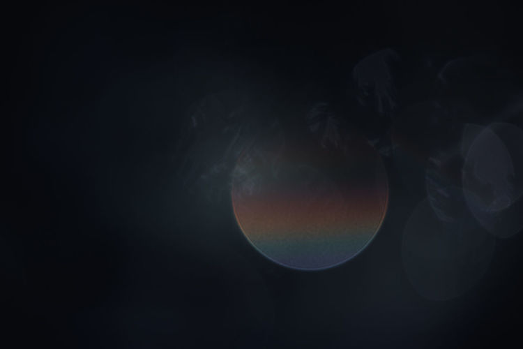 Digital composite image of moon against black background