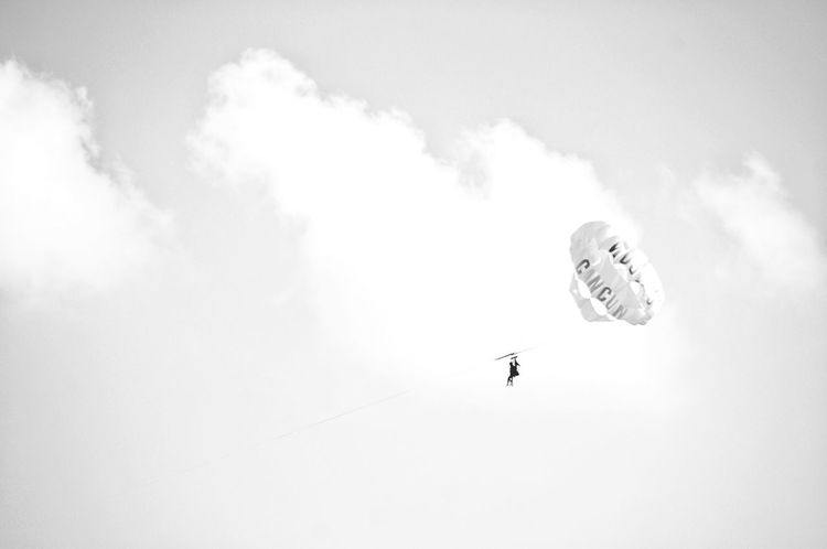 Low Angle View Adventure Parachute Parasailing Real People Unrecognizable Person Black And White Leisure Activity From Where I Stand Day Travel Destinations Vacations Paragliding Landscape Cloud - Sky Extreme Sports Sky Flying Vacations Outdoors Lifestyles Nature One Person Paragliding People
