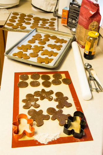 Baking cookies Baking Sheet Christmas Close-up Cookie Day Food Food And Drink Freshness Gingerbread Man High Angle View Indoors  Indulgence Large Group Of Objects No People Ready-to-eat Shape Still Life Sweet Food Table Temptation