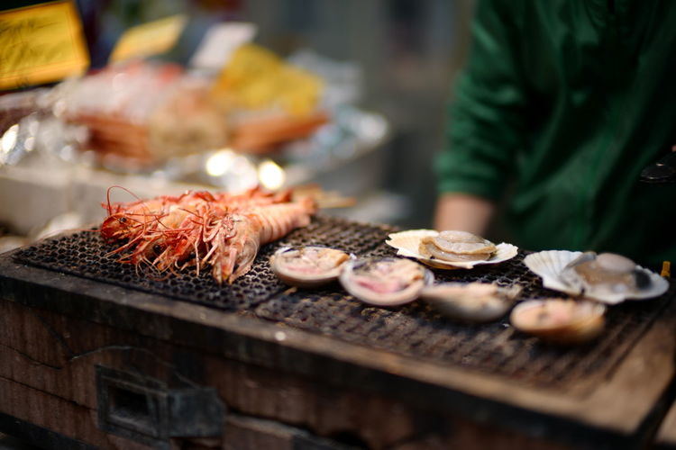 Close-up of meat on barbecue grill at market