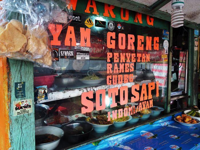 Information sign at market stall