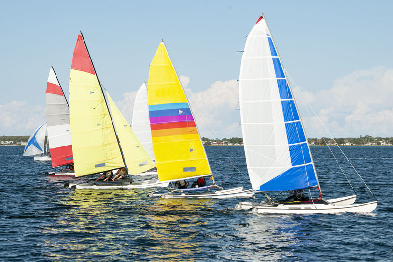 People in sailboats on sea