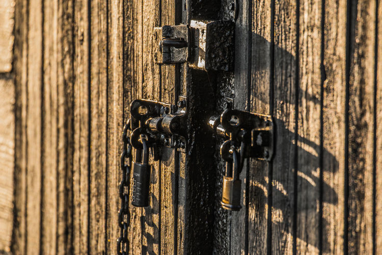 All locked up Doors Backgrounds Chain Close-up Combination Lock Day Door Full Frame Hasp Latch Lock Metal No People Outdoors Padlock Shadow Textured  Vertical Lines Wood - Material Wooden Door Wooden Door Detail