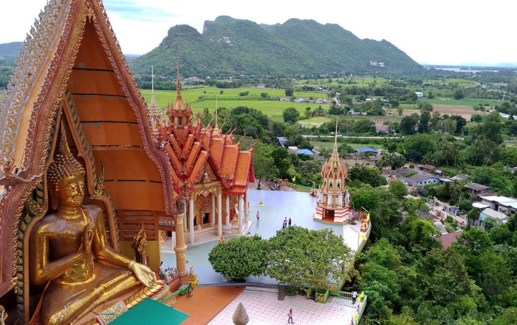 Temple of the Tiger, Attractions in Kanchanaburi, Thailand. Ancient Architecture Beautiful Belief In Thailand Buddha Temple Faith Kanchanaburi Thailand Sky And Clouds Statue Thames Art Attraction Background Texture Building Culture Golden Color Landmarkbuildings Old Buildings Pagoda Building Sua Temple - Building Thailandtravel Tourism Destination Traditional Travel Destinations
