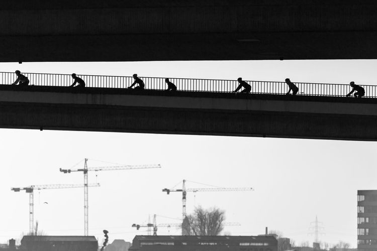 Duesseldorf, Germany Bicycles Bicycling Blackandwhite Bridge Brücke Crane Day Duesseldorf Düsseldorf Low Angle View Outdoors Radfahren Radfahrer Radrennen Rheinkniebrücke Silhouette Tour De France EyeEm Ready