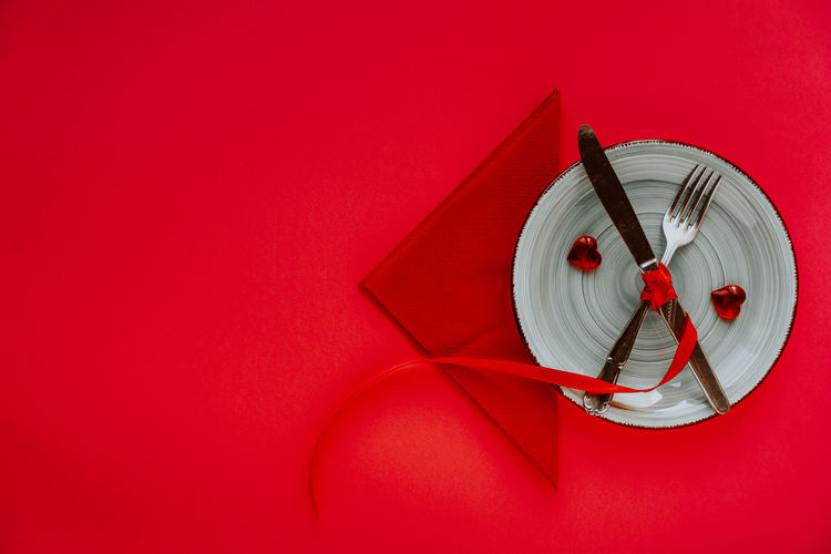 High angle view of clock on red wall