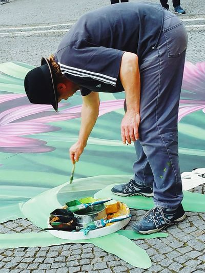 Full length of artist painting on street