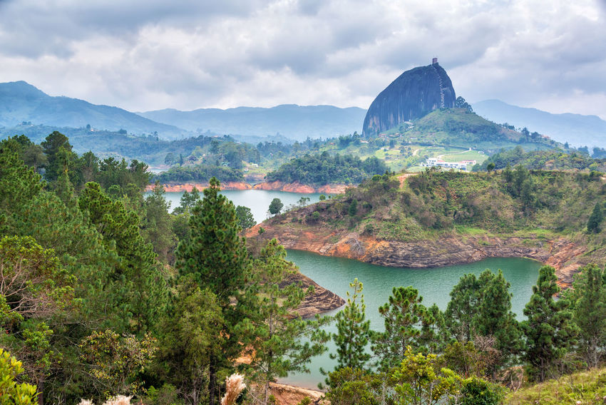View of The Rock near the town of Guatape, Antioquia in Colombia Antioquia Beauty In Nature Blue Sky Building Cloudy Colombia Countryside Guatape High Islands Lake Landscape Lookout Medellín Natural Outdoors Picturesque Rock Scenics South America Tranquil Scene Travel Tree View Water