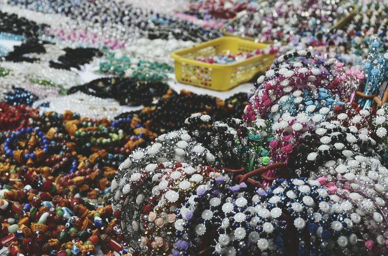 Close-up of jewelries at souvenir market