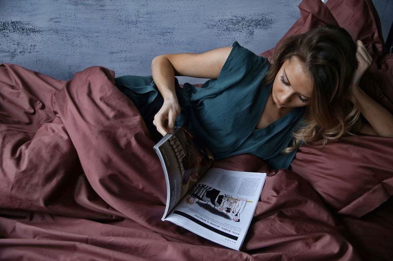 Girl in bed reading a magazine High Angle View Bedroom Bed Women Lying Down Indoors  Adult Adults Only Two People Togetherness People Only Women Young Women Day Young Adult Close-up