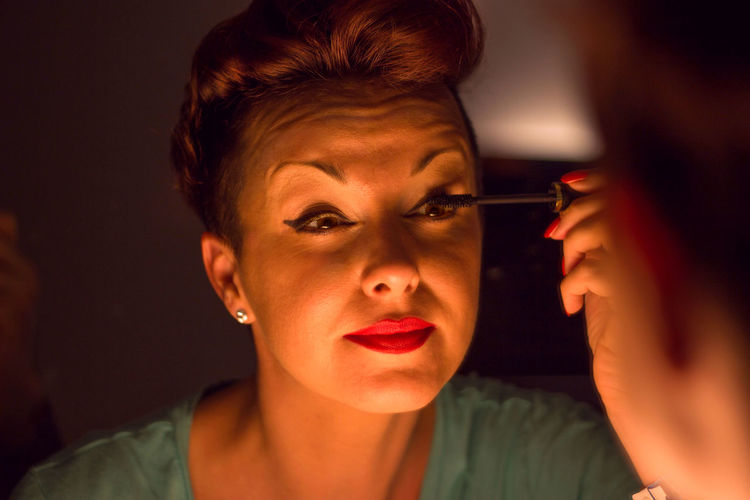 Close-Up Of Woman Applying Mascara