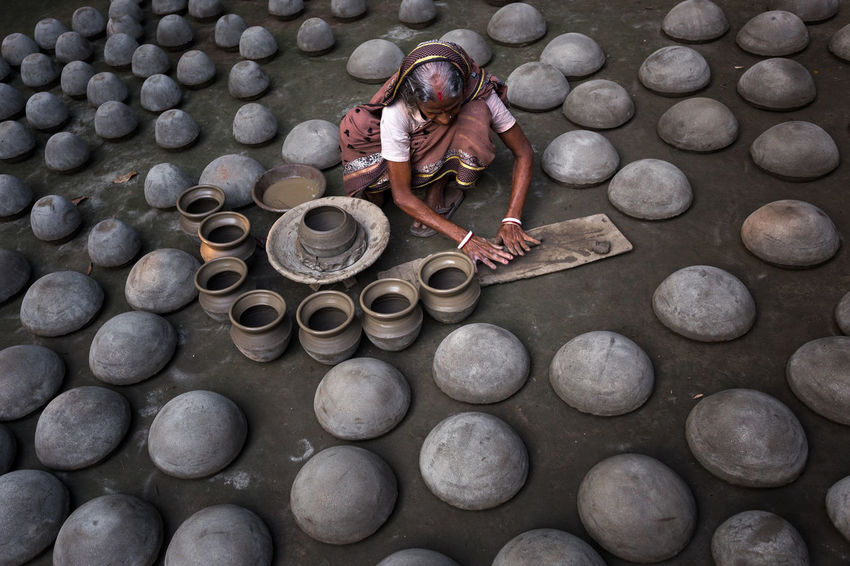Art of clay potter. One Person High Angle View Working Occupation Large Group Of Objects Outdoors Women Lifestyles Full Length Clay Art Arts Culture And Entertainment Art And Craft EyeEm Selects EyeEm Gallery Stone - Object
