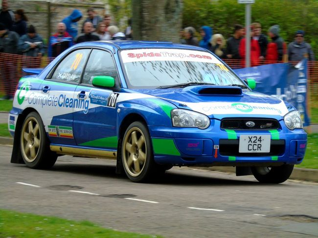 A Subaru Impreza blasting past the old library Uk Scotland Eye Em Scotland Racing Rally Car Pushing It To The Limit Loud Rally Cars Rallygallery Race Fast Cars Outdoors Day Car Rally Auto Racing Automobile Cars Driving Driving Fast Subaru Impreza Road Rally!!! Eyeem Cars Fast Driving