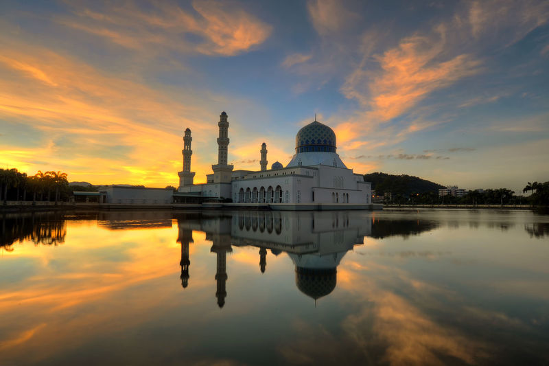 Kota Kinabalu Architecture Bandaraya Mosque Belief Building Building Exterior Built Structure Cloud - Sky Dome Government Lake Nature No People Place Of Worship Reflection Religion Sky Spirituality Sunset Travel Destinations Water Waterfront