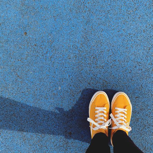 Walking in my shadow Trainers Daps Shadow Yellow Blue Shoe Personal Perspective One Person Standing Directly Above High Angle View