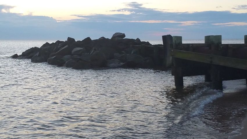 Water Sky Sea Built Structure Architecture Nature Beauty In Nature Scenics - Nature Waterfront Sunset Tranquil Scene Cloud - Sky No People Beach Tranquility Day Rock Land Outdoors