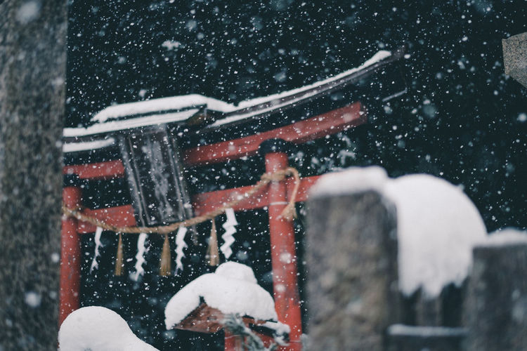 View of torii gate during snowfall