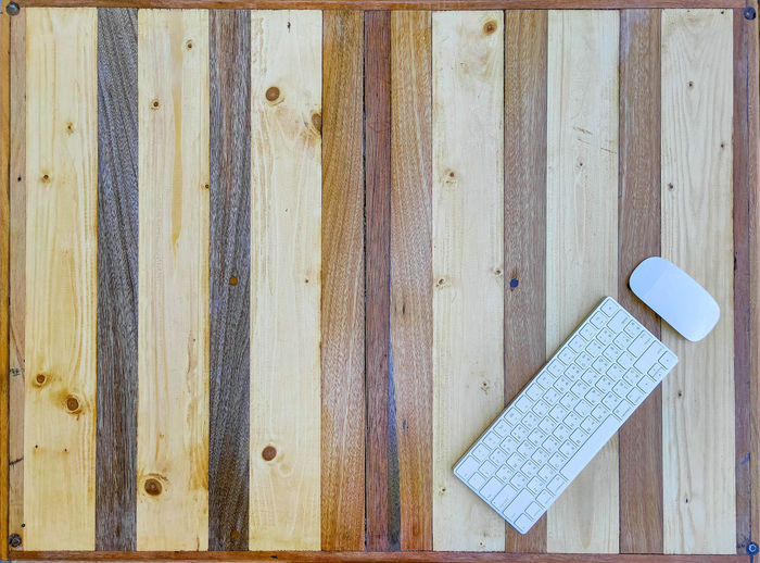 High angle view of text on wooden plank