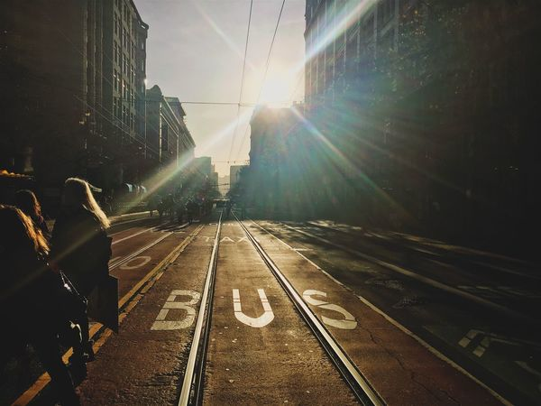 Crossing SF City Life Sun Flare Urban Life Crossing The Street Transportation Railroad Track Lens Flare Public Transportation Built Structure Road Architecture City Outdoors People