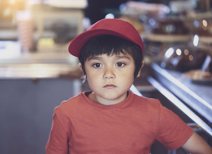 Close-up of boy looking away in cafe