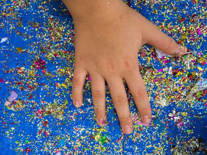 Child hand on a table full of glitter. Real People One Person Multi Colored High Angle View Leisure Activity Close-up Human Hand People Colours Colors Colourful Fabulous Childhood Memories Child Hand Sensory Crafts Learning The Week On EyeEm Blue Hand Mix Yourself A Good Time Mix Yourself A Good Time Be. Ready.