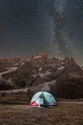 "After few hours of hiking we reached the ""Val Venegia"" in the south of Dolomities. We found ourselves in front of the Blades of San Martino that arose from the meadows. Epic view, epic sunset, epic starry night. This is the campsite where the stars warmed our soul. Tent Camping Mountain Beauty In Nature Nature Landscape Environment Land Milky Way Sky Galaxy Adventure Night Outdoors Mountain Peak Tranquility Space Scenics - Nature Star - Space"