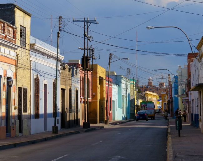 Walking thru the colorful streets of Merida city. Mexico Mexico Mérida Yucatán Mérida Canonphotography Traveling Taking Photos Travel Photography Photooftheday Eye4photography  Streetphotography City Life Street Photography City Architecture Building Exterior Built Structure Street Transportation Road Electricity Pylon Residential Structure City Street Power Line  Cable