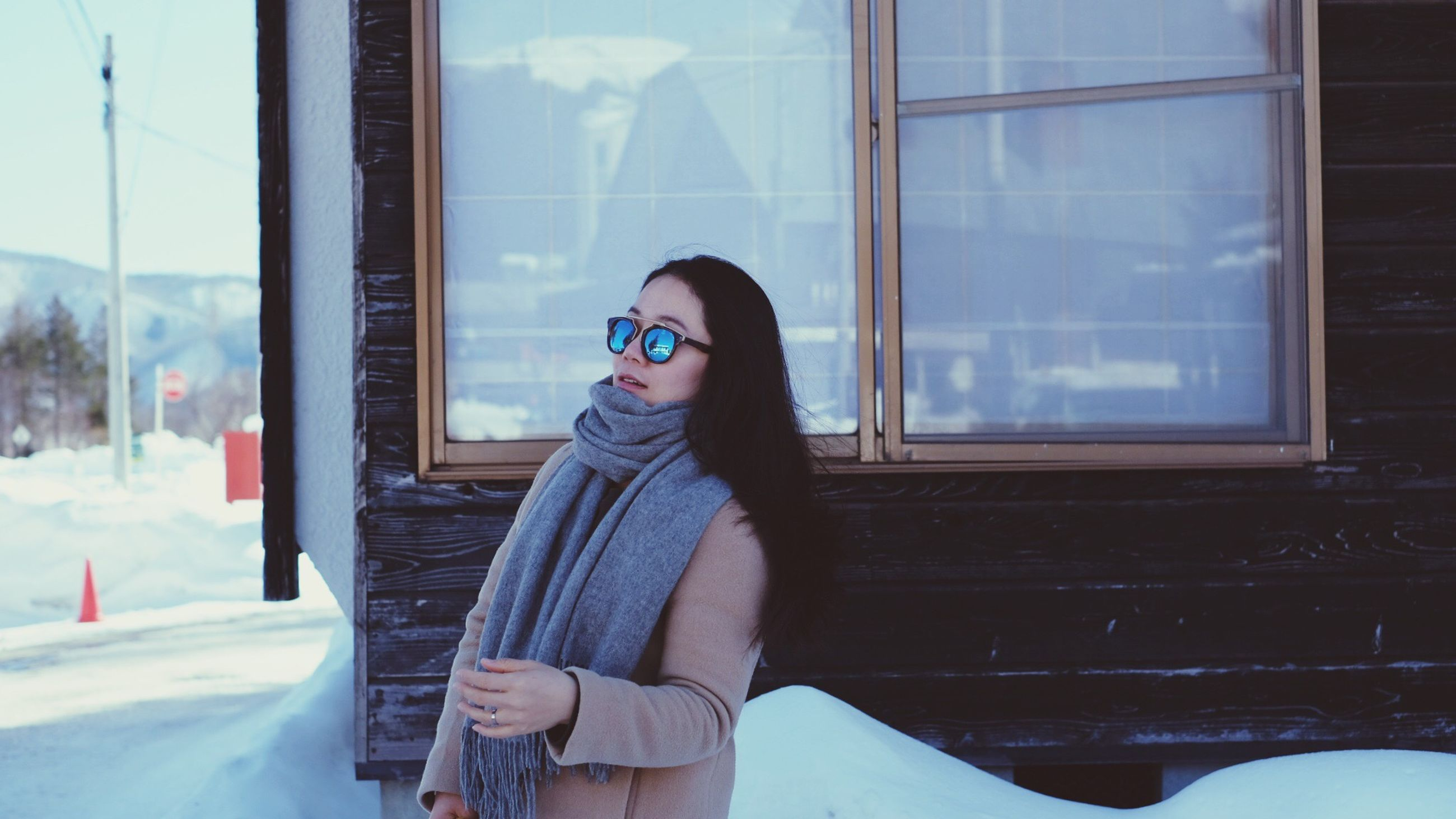 window, young adult, one person, portrait, winter, women, young women, adult, adults only, day, one woman only, city, only women, warm clothing, indoors, people, one young woman only