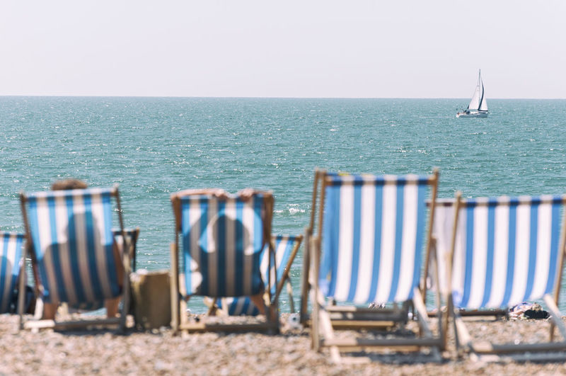 Summer Breeze Enjoying Life Relaxing Relaxing EyeEm Best Shots EyeEm Nature Lover EyeEm Selects EyeEm Gallery Holiday Holidays Summertime Sunny Tranquility Travel Beach Beach Chair Beach Chairs Human Shadow Sailboat Sailing Boat Scenics - Nature Sea Shadows Summer Sunbathing Sunny Day Tranquil Scene Tranquility Travel Destinations Summer Exploratorium #FREIHEITBERLIN